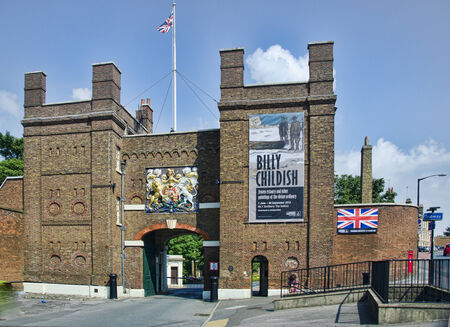 The main gate into Chatham dockyard with flag flying and crest above gate