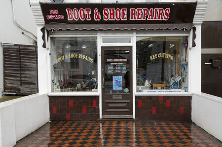 shop front: Frontage of a boot and shoe repair shop Editorial