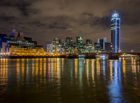 Vauxhall bridge at night with the MI6 building and tower blocks at St George Wharf on the Albert Embankment photo