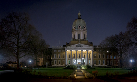 Imperial War Museum in London, lit up at night Editorial