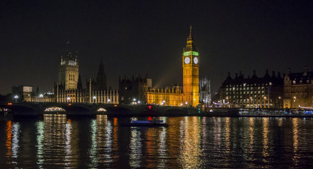 Big Ben, the Houses of Parliament and Westminster Bridge at night, London, UK photo