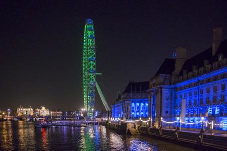 london eye: London eye at night on the river Thames in uk.