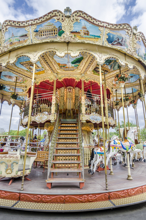 carrousel: Traditional Parisian carousel with painted Parisian landmarks