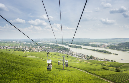View of the river Rhine and Rudesheim with cable cars in the foreground passing over vineyards Editorial