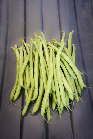 A bunch of green beans in portrait format photo