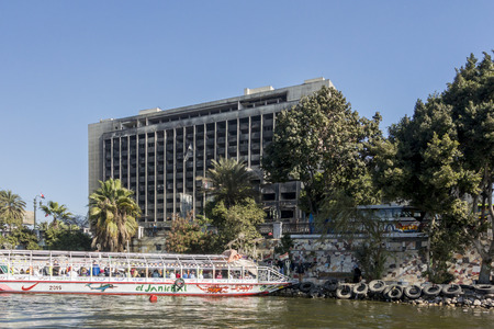 egypt revolution: CAIRO, EGYPT, 05 JANUARY 2015 - government building on the bank of the river Nile, destroyed during the Egyptian Revolution of January 2011