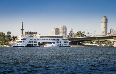 pleasure ship: Pleasure ship on the River Nile with tower blocks in the background
