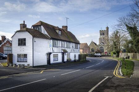 kent: BIDDENDEN, Kent, UK, JANUARY 2015 - High street with historic timber tea rooms and church