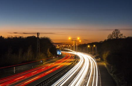 night highway: Car light trails on the M20 motorway in Kent, UK Stock Photo