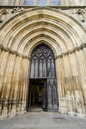 Ornate gothic arched door to York Minster photo