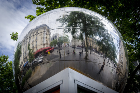 PARIS, FRANCE, 20 MAY 2012 - Reflections in a mirror ball in the city of Paris.  A sculpture \The fourth apple\ in Clichy Boulevard, a monument to the thinker Charles Fourier
