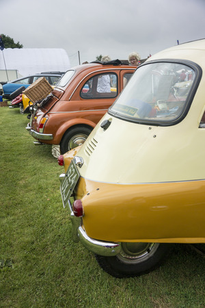APPLEDORE, KENT, UK, 20TH JULY 2014 - Rear view of a BMW Isetta and other classic cars