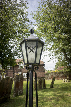 churchyard: Lamp in churchyard at Appledore, Kent, UK, with crossed swords on the glass Stock Photo