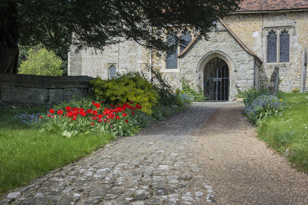 buttercups: Saint Martin of Tours Church entrance in the village of Detling Kent UK
