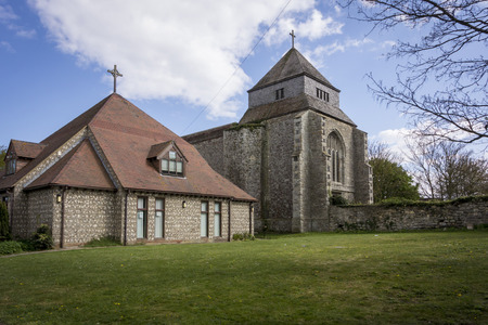 minster: Minster Abbey on the Isle of Sheppey Kent with Minster Hall in the foreground Stock Photo