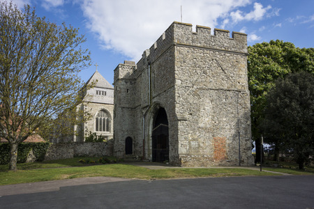 gatehouse: Minster Abbey on the Isle of Sheppey Kent with Minster gatehouse museum in the foreground Editorial