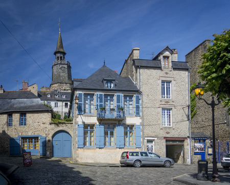 dinan: DINAN, BRITTANY, FRANCE, 15 JUNE 2015 -  medieval cobbled street and buildings in the city of Dinan, Brittany, France Editorial