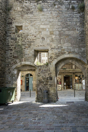 archways: Two archways in the stone city wall of Dinan, Brittany, France