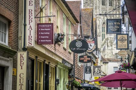 canterbury: BUTCHERY LANE, CANTERBURY, KENT, UK, 28 JUNE 2015 - View of the various shop signs in Butchery Lane, Canterbury