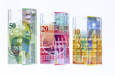 swiss franc note: Swiss francs money and currency of Switzerland on a white background Stock Photo