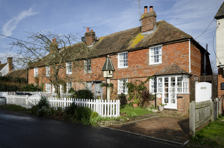 kent: WOODCHURCH, KENT, UK, 25 JANUARY 2016 - Row of brick and tiled cottages in the village of Woodchurch, Kent, UK