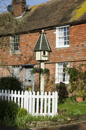 kent: Brick and tiled cottage with a dovecote in the garden, in a village in Kent, UK