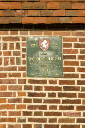kept: Plaque depicting Woodchurch village as being winner of the Best Kept Village competition in 1960, 1983 and 1986, Kent UK