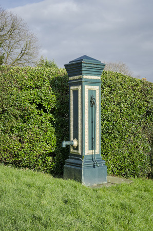 build in: Ancient water pump build in 1878 in the village of Woodchurch, Kent, UK Stock Photo