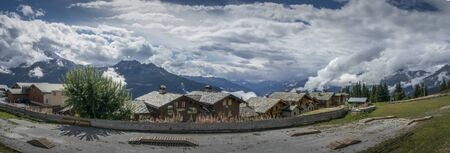 chalets: Panorama of the French Alps with Chalets in the foreground at La Rosiere, France