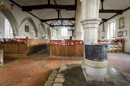 Interior of Saint Augustines church, Brooklands, Romney Marsh, with lead font in the foreground Editorial