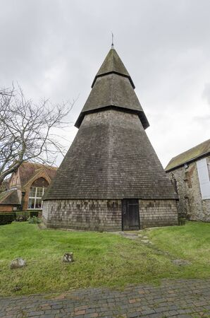 romney: The bell tower of Saint Augustines church, Brookland Romney Marsh, Kent, is completely detached from the rest of the church and made entirely of wood.