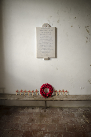 ST GEORGE'S CHURCH, IVYCHURCH, KENT, UK, 25 FEBRUARY 2016 - War memorial for the great war of 1914 - 1918 and poppy tributes