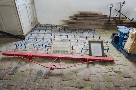 harrow: Ancient harrow on display on a brick floor Stock Photo