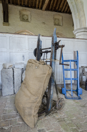 farm equipment: Antique farm equipment, sack barrows with hessian sack on one