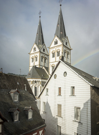 steeples: The church steeples of Saint Severuss Church in Boppard, Germany, with a rainbow after the storm