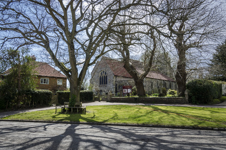 Saint George church and green int he village of Brede, Kent, UK Stock Photo
