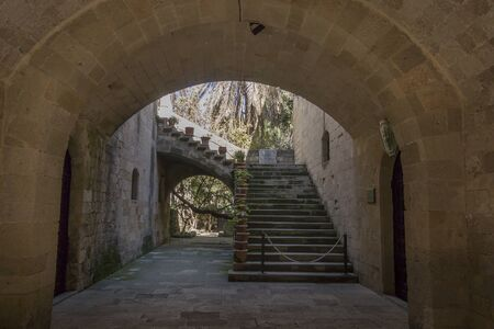 Covered, arched passage in the medieval town of Rhodes, Greece