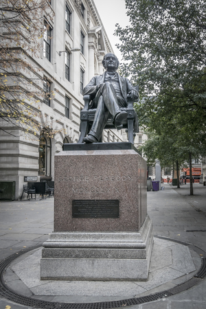 Statue of George Peabody, benefactor of the London poor, in the city of London, UK