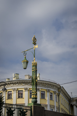 Street lamp with a gilded double-headed eagle in Saint-Petersburg, Russia Stock Photo