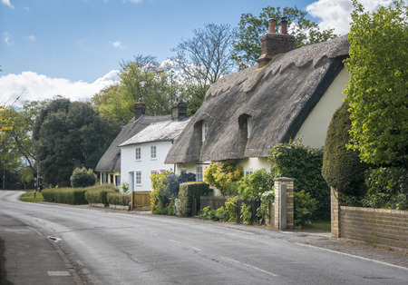 Street view of old thatched cottages in the pretty village of Foxton, Cambridgeshire, England, UK
