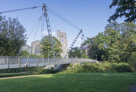The Millennium bridge over the river Medway  at Maidstone, Kent, UK with All Saints church in the background Reklamní fotografie