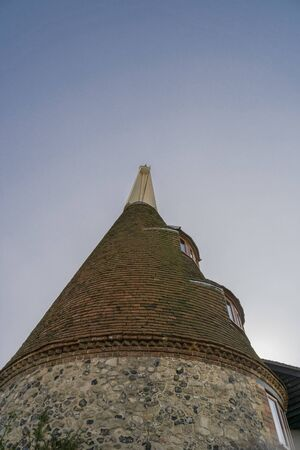 Looking up at an oasthouse roof in Kent, UK