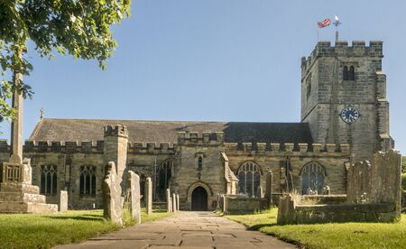 Entrance of St Laurence Church in the ancient village of Hawkhurst, Kent, UK Фото со стока