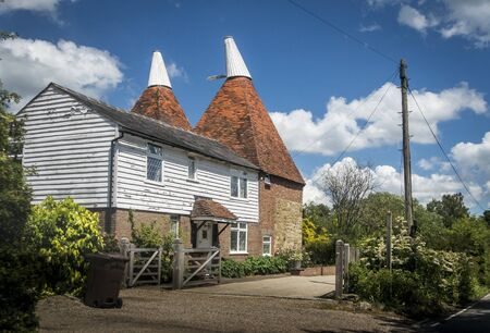 An oasthouse converted into houses in Kent, UK Фото со стока