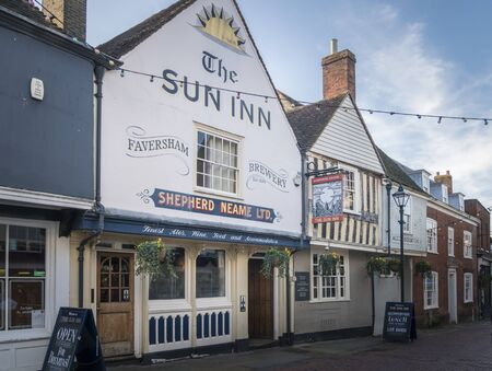 Facade of The Sun Inn public house in the medieval market town of Faversham, Kent, UK