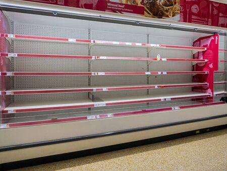Empty meat shelves in the supermarket due to coronavirus panic buying