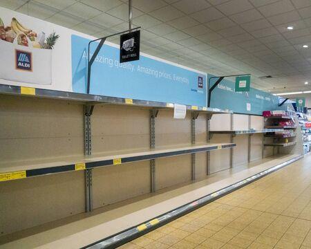 Empty toilet roll shelves in the supermarket due to coronavirus panic buying