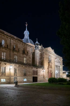 Facade of the University of Salamanca lit up at night, in the city of Salamanca, Spain