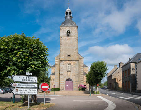 Street view of the Catholic Church in the town of Carrouges, France 免版税图像