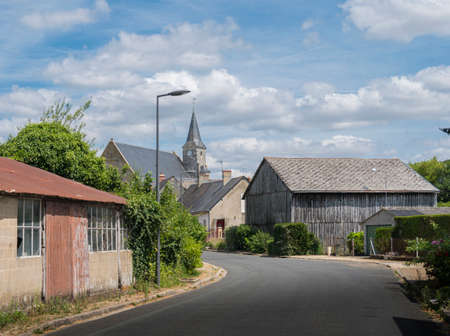 Street view entering a typical quiet French village, France